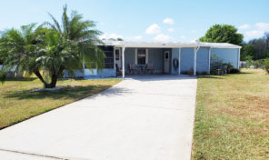 LOTS OF SPACE, LARGE DRIVEWAY and PLENTY OF BONUSES IN THIS HOME IN HIDDEN GOLF