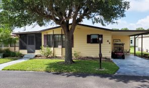 This doublewide in Swiss Golf & Tennis is priced to sell!